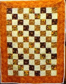 Simple but soothing quilt, like the falling leaves in October.