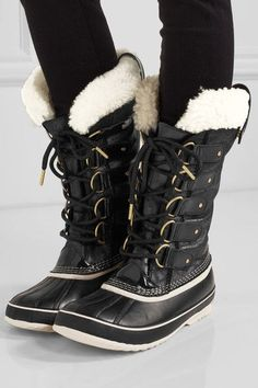 Sole measures approximately 30mm/ 1 inch Black leather, cream shearling Lace-up front Imported