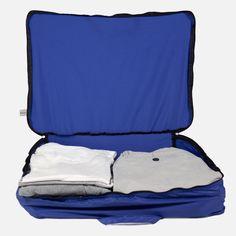 Organizador 812 azul: Bolsa ultraligera para organizar la ropa comodamente en la maleta o guardarla protegida en los armarios de casa. Se puede lavar, transpira y vacía no ocupa prácticamente nada.