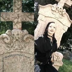 Cemetery in Hungary (me!)  #cemetery #gothic #metal #metalgirl #skull #tomb #tombstone #makeup #goth #piercing #witch
