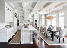 Crisp White Kitchen. Kitchen with crisp white kitchen cabinets and walls. These are Calacatta marble countertops. #Kitchen #CrispWhiteKitchen #WhiteKitchen