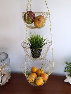 Beautiful vintage metal mesh 3 tier hanging basket Completely collapsible Has a hook at the top for easy hanging Good as a planter outdoors or indoors, as a fruit or other food basket in the kitchen, or to help organize whatever your hearts desire.  Measures: total length 36 long largest bottom basket 10.75 diameter at the top 6 deep middle size basket 9 diameter 4.75 deep small basket just under 7 diameter 3.5 deep  CONDITION REFERENCE CHART RATING: Excellent never been used  Thanks for…