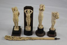 Lot 6 - Four 1930`s Indian ivory figures of nude women, in various poses, each standing on a shaped horn and