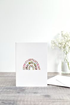 A lovely handmade Liberty fabric sewn rainbow card. Made from pretty floral Liberty fabric stitched directley onto the card using freehand machine embroidery. This simple but elegant card can used for any occasion. Handmade by Stitch Galore #rainbowcard #embroideredrainbow #sewnrainbow #handmadecards #embroideredcard #embroideredcards #stitchedcard #stitchedcards #sewncard #fabriccards #libertyfabriccards #uniquecard #custommadecards #freehandmachinembroidery #freemotionembroidery Congratulations New Home, Anniversary Congratulations, Happy Anniversary Cards, Happy Birthday Cards, Freehand Machine Embroidery, Free Motion Embroidery, New Home Cards, Rainbow Card, Fabric Cards