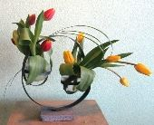 Sculptural Happiness - Fall tulips in a swirled concrete and steel vessel - from $35- $99 (lower end with rental vase and a bit simpler, still very visually interesting)