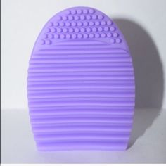 Light purple Brushegg makeup brush cleaner Selling a light purple   brush egg. Used to clean your dirty makeup brushes! Just add soap to the egg and move the brush up and down! 3x3x1 inches 100% silicone   Colors available: light purple, hot pink, fuchsia purple, mint blue  Price firm unless bundled  Clinique Chanel urban decay MAC benefit cosmetics Laura mercier Estée Lauder kat Von D smashbox two face bare minerals Avon Mary Kay brush egg Makeup Brushes & Tools