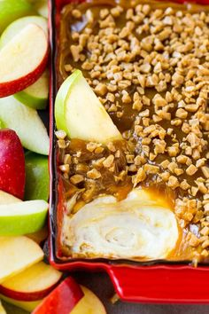 Caramel apple dip with an apple slice in it.