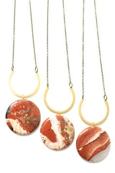 love the unique shades of red with mix of gold and brass