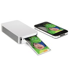Pocket this smartphone/tablet printer to share photos without cords, toner, or even the Internet. - Hammacher Schlemmer