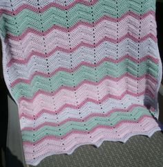 Baby Blanket - Ripple Stitch Ripple Stitch Baby Blanket is Hand Crocheted in Rose, Green, White and Lt. Pink Made in a soft yarn, this blanket measures 27 x 30 inches and is completely machine washabl