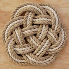 The Carrick Mat, also known as a Thump Mat, is traditionally placed around a ring bolt on the deck of a ship as chafing gear - to deaden the sound of the block falling and to save wear on the deck.