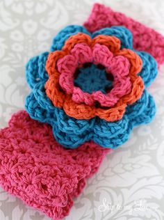 crochet ear warmer pattern - love the flowers and the colors!