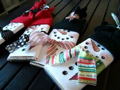 candy bars wrapped in white paper; draw snowman features wrap with fabric scarf use mitten as cap