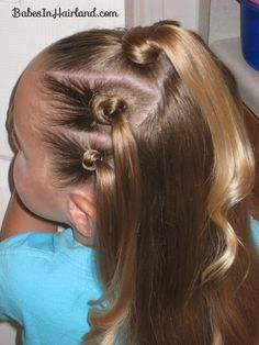 Knotty Flower Girl - This web site has a lot of cute hair styles for little girls.