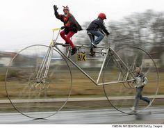 This bike isn't giant size, the people are super small, and they're having an adventure.