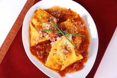 Tortelli of Potato and Chives All' Arrabbiata  by Mario Batali  This dish is so simple and yummy.  It's amazing the difference homemade pasta will do for a dish.