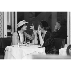 Mark Shaw-Editioned Portrait of Coco Chanel #7 , Paris, 1957. Coco Chanel as captured by Mark Shaw for LIFE Magazine in 1957. Chanel is seen here lunching at the garden restaurant at the Ritz in Paris with Jessica Daves, editor in chief of VOGUE. via Boom Chappell