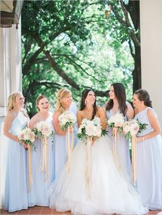 With this year's pantone color of the year, serenity, add a dreamy color to your wedding party's attire.