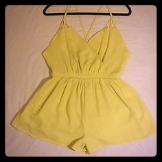 Spaghetti-strap romper Crisscross (low-sitting) straps in back, with small zipper. Shorts are high so it may look like a mini-dress. Such a cute fit! Perfect for brunches, the beach, or any daytime outing. Very J Pants Jumpsuits & Rompers