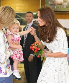 Kate smiles with a little girl who has just given her flowers -- probably hoping she's buttering up her future mother-in-law...