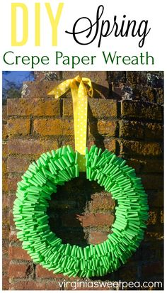 DIY Spring Crepe Paper Wreath - Learn how to make a crepe paper wreath for spring. Customize the look with your choice of crepe paper and ribbon colors. #wreath #springwreath #springcraft #crepepaper #crepepapercraft