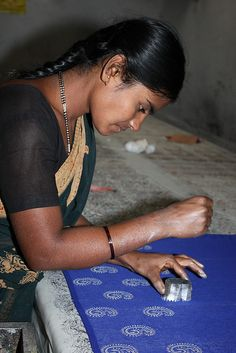 Woman from the Deepa Block Printing Group 1 Deepa means Lamp in Kannada. In quiet Halasur village around 15 women have become skilled in the traditional technique of hand blocked printing and produce clothing, accessories and home furnishings.