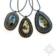 "Anna Nieśpiałowska, Sol. Embroidered pendants with amazing ""cosmic"" labradorites.  http://polandhandmade.pl/kategorie/beading/niespialowska-anna-sol/  #spacejewelry #labradoritejewelry #cosmicjewelry #multicolormedallion #rainbowlabradorite"