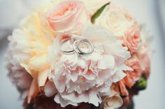 Bride bouquet with white pink and peachy peony and roses