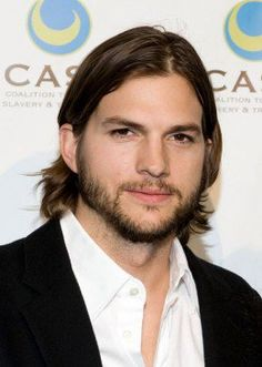 Ashton Kutcher, 35, wears his long layered hair parted just slightly to the side. - 2013 Hairstyles for Men Short Medium Long Hair Styles Haircuts, by Rosie2010