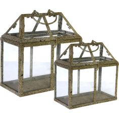 Arrange your favorite potted plants or display an eclectic group of candles in these glass terrariums, showcasing a distressed finish for rustic appeal....