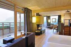 Stay in the rooms and suites made of moon wood in our wellness hotel forsthofalm in leogang. nice offers and attractive prices for our room and suite in the hotel up in the mountains Hotels, Das Hotel, Places To Go, Wellness, Building, Salzburg, Austria, Sustainability, Furniture
