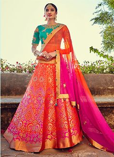 Give in to the colourful confluence of today and tomorrow in this stunning orange and pink banarasi silk lehenga choli. This lehenga choli is decorated with patch border work and embroidery work. Comes with matching choli and dupatta. Choli Designs, Lehenga Designs, Indian Bridal Wear, Indian Wedding Outfits, Indian Outfits, Indian Attire, Indian Ethnic Wear, Indische Sarees, Banarasi Lehenga