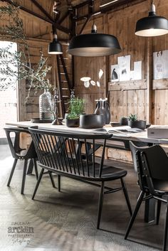 Dining area in black and wood in a barn photographed by Paulina Arcklin