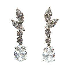 3.37 Carats GIA Cert Oval Drop Diamond Gold Earrings   From a unique collection of vintage drop earrings at https://www.1stdibs.com/jewelry/earrings/drop-earrings/