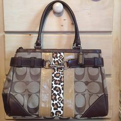 Coach Purse Like brand-new brown Coach purse with leopard and tan front detail! No scratches, tears, or stains. Three inside pockets: one zip and two open pockets. Can be worn on forearm or shoulder. Coach Bags Shoulder Bags