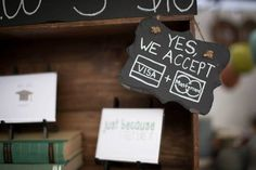 Use a mini chalkboard to create a we accept sign