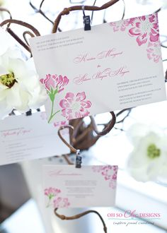 Another photo of the watercolor invitations with custom illustrated flowers.