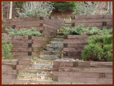 tiered retaining wall idea with stairs for backyard