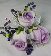Purple rose wrist corsage for wedding