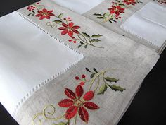 Christmas embroidered tablecloth with the easter flower over border beige fabric and topped with a red hemstitch. Christmas Embroidery Patterns, Hand Embroidery Patterns, Machine Embroidery Designs, Christmas Sheets, Christmas Table Cloth, Swedish Weaving Patterns, Cross Stitch Tree, Easter Flowers, Embroidered Towels
