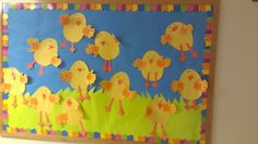 Spring or Easter Bulletin Board created by my friend Anne using kids' hand prints.