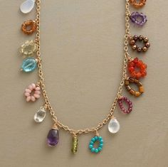 "All the colors of the rainbow and more, in tiny bead loops and drops on a 14kt goldfilled chain, to wear long, doubled, even tripled. Gems include cultured pearls, turquoise, amethyst, opal, garnet, chalcedony, peridot and more. Made in USA. 52""L."