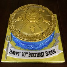 - Percy Jackson cake. The top is completely edible, made from cake, fondant, royal icing and airbrushed with gold.