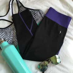 Electric Yoga purple and black workout pants Perfect lay flat purple band at the top and great stitching down the legs! 88% polyamide, 12% elastane. NWT retail. Electric Yoga Pants