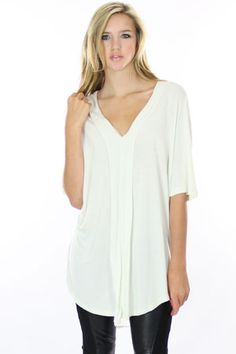 white blouse - I like this blouse. It looks casual with a touch of sassy. It looks like a shirt that I could wear around the house or a blouse that I could wear out.