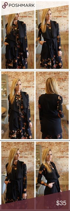 | boutique | vest Black draped front vest with tie. Sleeveless. Pockets at side. Originally purchased from Suzanne @scanon photo credit to her for first 3 photos. New with tags. 98% polyester 2% spandex Boutique Jackets & Coats Vests
