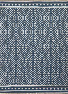 classic blue and white area rug with modern attitude - great tribal pattern - find house decorating trends - Floret Indigo Blue Flatweave Area Rug