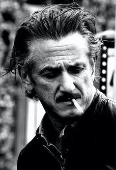 Sean Penn Photos - Sean Penn smokes a cigarette and pulls his luggage behind him while in town to attend the Annual Cannes Film Festival. - Sean Penn Smokes at Cannes Sean Penn, I Movie, Movie Stars, Les Sopranos, Don Corleone, Looks Black, Celebrity Portraits, Black And White Portraits, Hollywood Actor