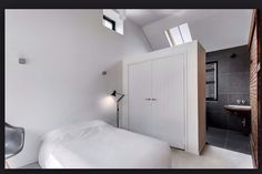Large wardrobe serves as a room divider between the attic bedroom and bathroom. home decor and interior decorating ideas. Box Bedroom, Condo Bedroom, Bedroom Closet Design, Small Bedroom Designs, Master Bedroom Closet, Wardrobe Design, Closet Designs, Small Bedrooms, En Suite Bedroom