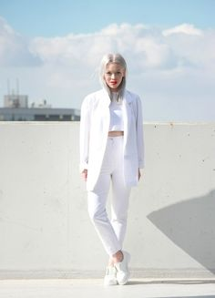red lips are a nice add to this 'all white' outfit